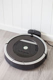 Robotic vacuum cleaner charging battery smart cleaning technolog Stock Photography
