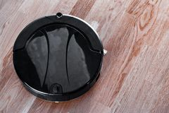 Robotic vacuum cleaner controlled by voice commands to direct cleaning. Modern smart cleaning technology, efficient dust royalty free stock image