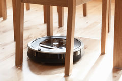 Robotic vacuum cleaner on laminate wood floor smart cleaning tec. Hnology problem Stock Images