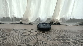 Robotic vacuum cleaner meets various obstacles stock video footage