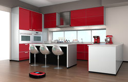 Robotic vacuum cleaner in a modern kitchen interior Stock Photo