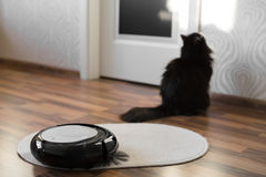 Robotic Vacuum Cleaner On Little White Carpet Royalty Free Stock Images
