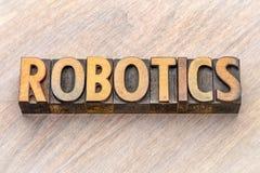 Robotica - woordsamenvatting in houten type stock afbeeldingen