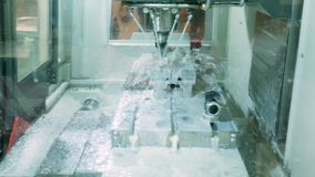Robotics automatic machine for milling steel parts in the industrial factory. Modern engineering concept stock video