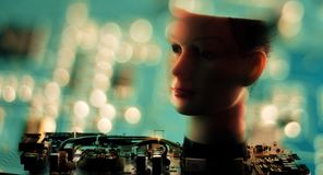 Robotics cyber science, ai robot head. Robot head and defocused circuit board, artificial intelligence concept stock photography