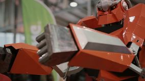 Robotics Expo. Close-up of boxer robot are bits the mannequin. Moving hands stock video footage
