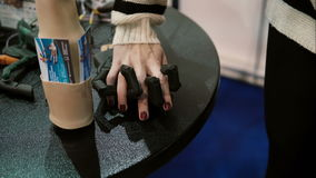 Robotics Expo. Human hand in mechanical hand, woman in love with robot. 4K stock video