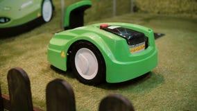 Robotics Expo. Robot lawnmower in grass close-up.Machine cutting grass. 4K stock video