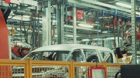 Robotics work in production line of car stock video