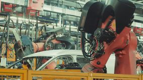 Robotics work in production line of car stock footage