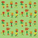 Robotmän på en grön bakgrund Arkivfoton