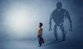 Robotman shadow of a cute little boy. Little boy s self image appear as a big robotman shadow on his backgroundn Stock Photography