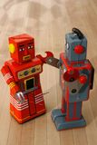 Robots. Two colorful retro/vintage robots Royalty Free Stock Images
