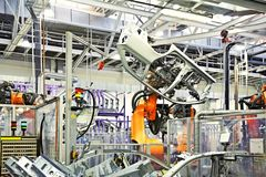 Robots in a car factory. Robotic arms in a car factory stock photography