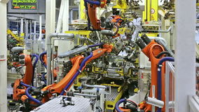 Robots in a car factory stock video footage