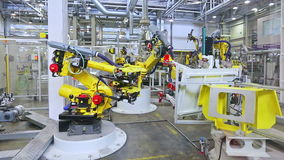 Robots in a car factory stock video