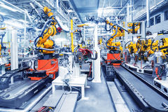 Robots in a car factory Royalty Free Stock Photography