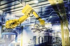 Robots dans le travail Photographie stock