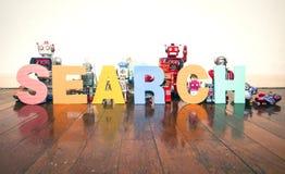 Robots de la búsqueda Imagenes de archivo