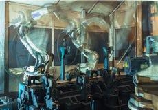 Robots de soldadura del equipo Foto de archivo