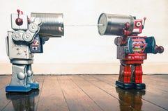 Robots del teléfono de la lata imagen de archivo libre de regalías