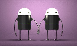 Robots with glowing heads holding hands Royalty Free Stock Photography