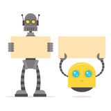 Robots holding blank poster Royalty Free Stock Photos