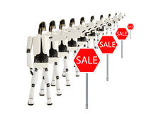 The robots indicates sale. Robots point a finger at sale, on a white background Royalty Free Stock Photography