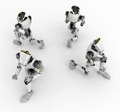 Robots Kneeling, 4 Sides. 3d robotic figures, over white, isolated Royalty Free Stock Photo