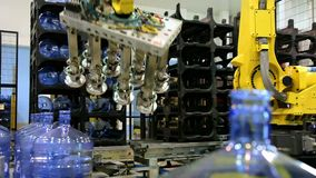 Robots loaders work in a warehouse. Water bottle conveyor industry. stock video