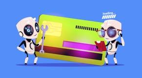 Robots modernos que se colocan sobre la tarjeta de crédito que lee documentos y que lleva a cabo concepto robótico del pago de la libre illustration
