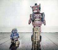 Robots pauvres riches Photos libres de droits