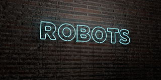 ROBOTS -Realistic Neon Sign on Brick Wall background - 3D rendered royalty free stock image Royalty Free Stock Photo