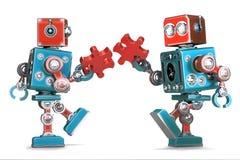 Robots retros que montan pedazos del rompecabezas Aislado Contiene la trayectoria de recortes Imagen de archivo