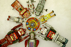 Robots. Robot gather round there mother ship royalty free stock photos
