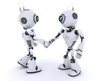 Robots shaking hands Stock Images
