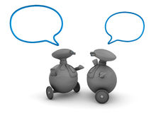 Robots with speech bubbles. Three dimensional illustration of two robots or androids with blank speech or communication bubbles; white background Royalty Free Stock Images