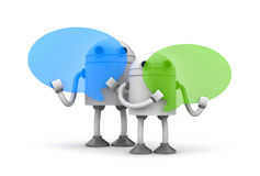 Robots with speech bubbles Royalty Free Stock Photography