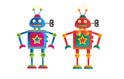 Robots. Two colourful robots, one female orintated , the other male. Set on a white isolated background on a landscape format image with a grunge style effect Stock Photos