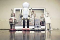 Robots watching Royalty Free Stock Photo