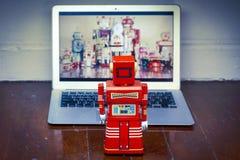 Robots watching Stock Photos