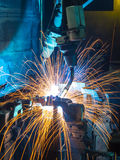 Robots welding automotive parts Royalty Free Stock Photography