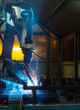 Robots welding in a car factory Royalty Free Stock Photos