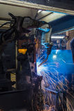 Robots welding in a car factory Stock Photos