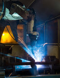 Robots welding in a car factory Royalty Free Stock Image