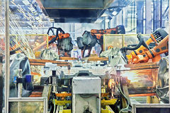 Robots welding in a car factory. See my other works in portfolio royalty free stock image