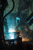 Robots welding in a car factory. Team welding robots represent the movement. In the automotive parts industry stock photos