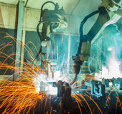 Robots welding team Stock Photography