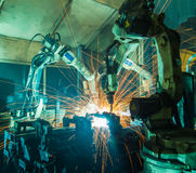 Robots welding team Royalty Free Stock Photography