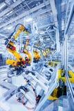 Roboty w samochodowej roślinie Zdjęcia Stock